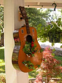 Pot Garden Ideas get a glimpse into darby stanchfields gorgeous garden Guitar Container Garden