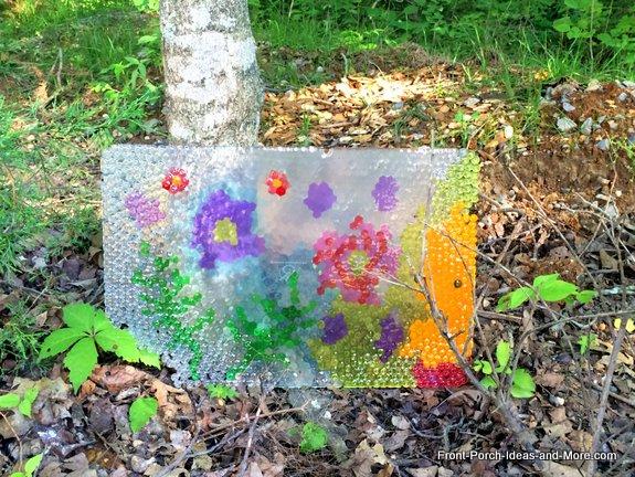 Love seeing the light shine through our whimsical garden art