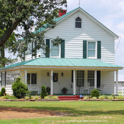 Porch Design Ideas mixing colors could spice up your front doors look Pleasant Country Front Porch With Green Standing Seam Metal Roof