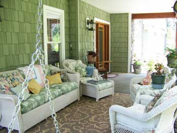 nicely decorated and furnished front porch