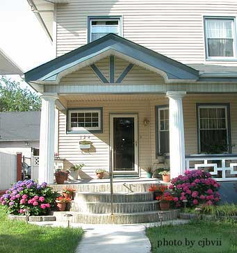 House with rounded porch steps