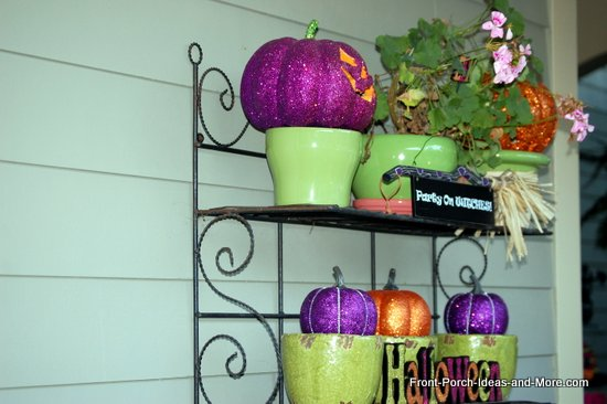 Orange and purple sparklies decorate this porch for Halloween