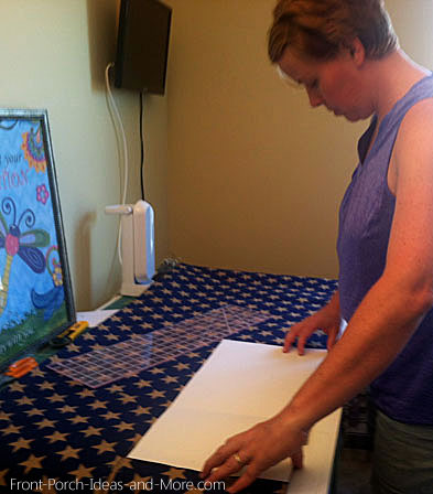 Marcia cutting the blue burlap to size