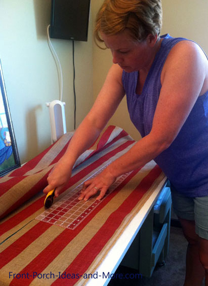 Marcia cutting the red burlap to size