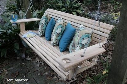 Beautiful cypress porch swing that even comes with cupholders (on Amazon). What will they think of next?