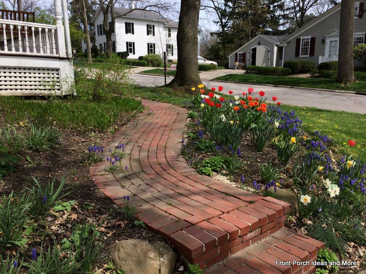 Curved brick walkway leading to porch