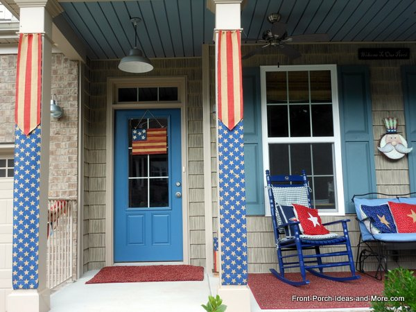 front porch columns with americana flag banners