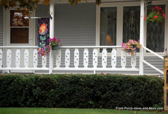 decorative balusters on quaint front porch