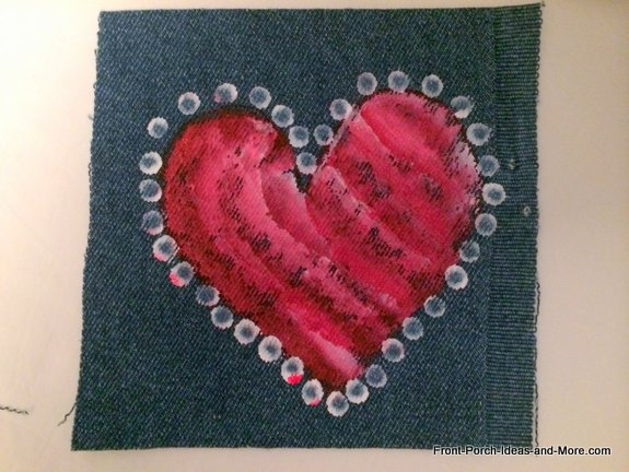 painted heart on swatch of denim