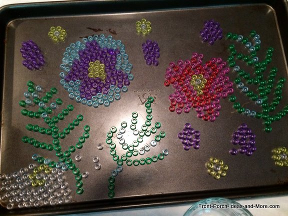 Cool garden art - I added some leaf and ferns to the bead pattern