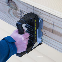 joist hanging tool in male's hand