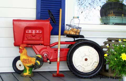 Old toy tractor on porch