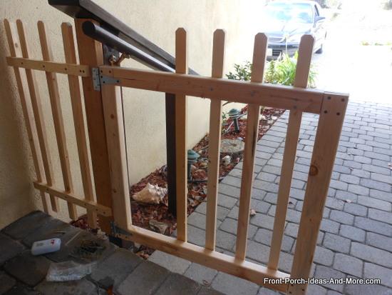 Build a porch gate build a picket fence gate for your porch for Porch gate plans