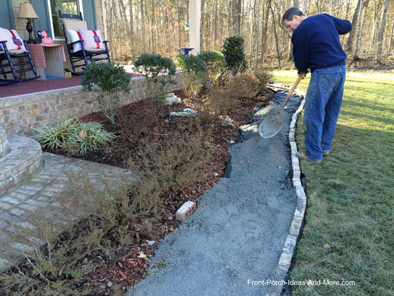 Shoveling Crushed Stone For Walkway