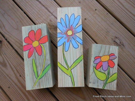 Simple spring flowers painted on scraps of wood.