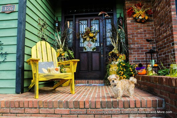 fall front porch with little dog