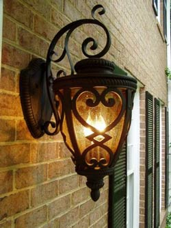 French quarter lantern hanging on brick house