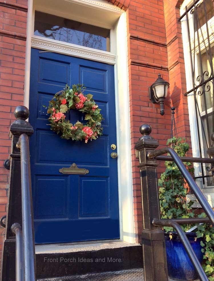 Floral front door wreath on a gorgeous blue door