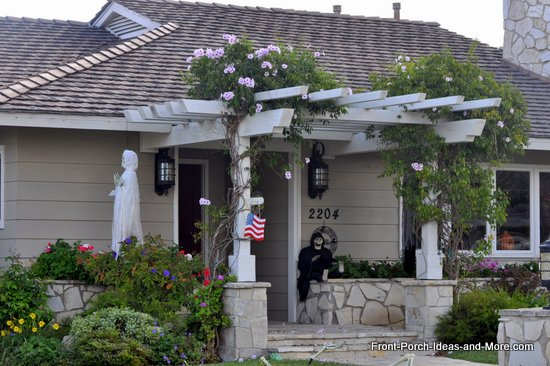 front porch with pergola roof and flowering vines