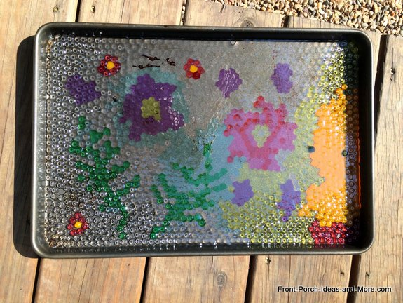 Cool garden art - melting the beads in our grill was a good move for keeping the fumes out of the house but we learned that our grill did not heat evenly