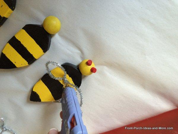 gluing bee wings on bees