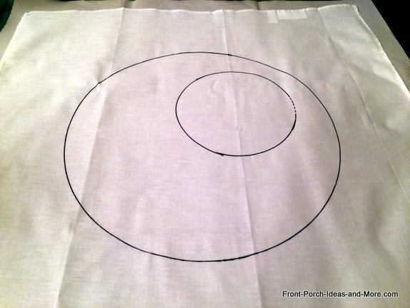 I started our Halloween pillow toppers by drawing a circle onto a piece of white cloth and then another smaller circle inside the large circle for the moon