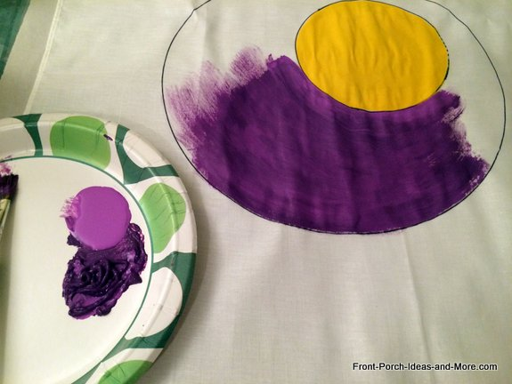 I painted the moon a bright yellow with acrylic paints and then started painting the background purple on my black cat pillow topper