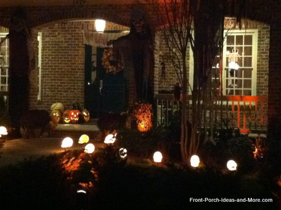 Ghoulish monsters on either side of the porch