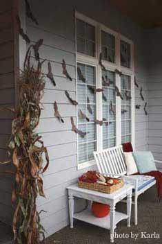 spooky bat decorations on front porch