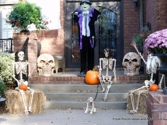 a family of bones and skeletons greet visitors to your front door