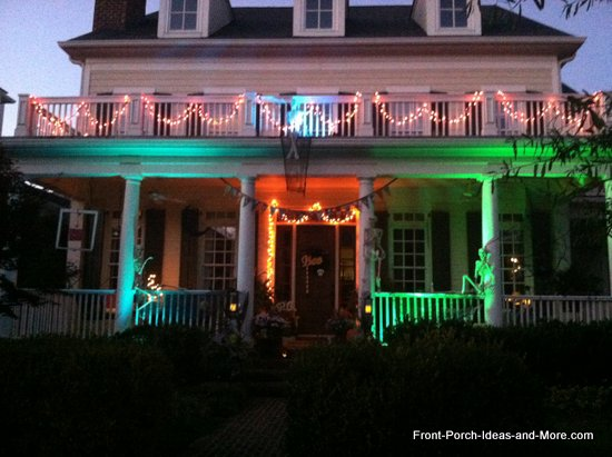 multi colored spotlights shine on skeletons - Halloween Outdoor Lights