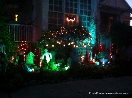 use the landscaping around your front porch to fill with goblins headstones and twinkle lights - Halloween Light Ideas