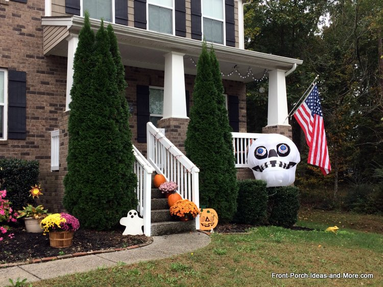Halloween porch with large inflatable skeleton head