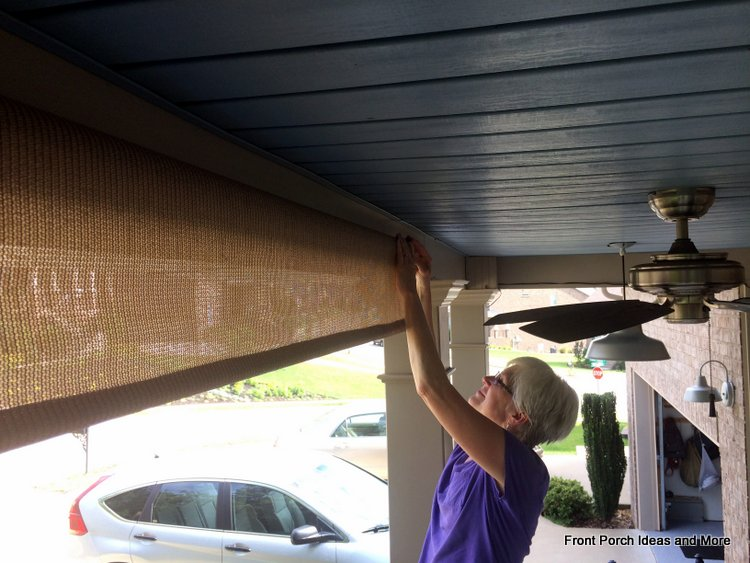 inserting porch shade assemblies into holders