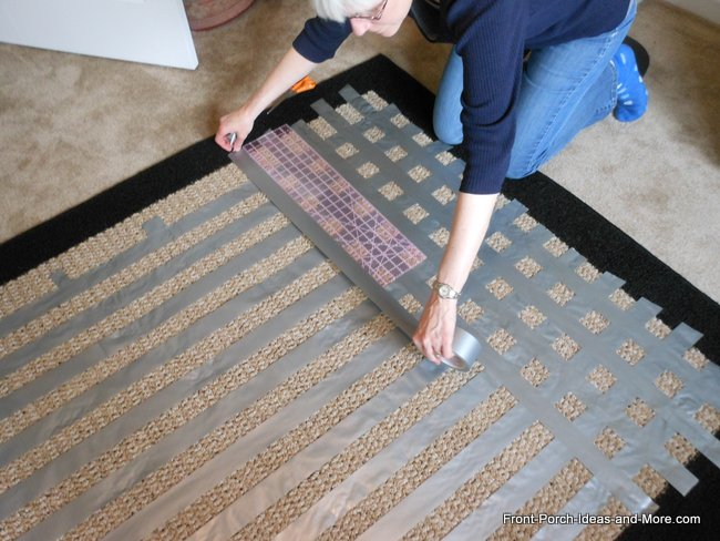 laying down the horizontal stripes on the rug next