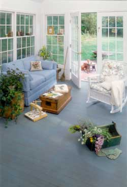 Double-hung windows and beautiful blue carpet make inviting room