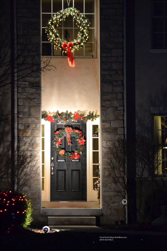 two sophisticated outdoor christmas wreaths on front of home
