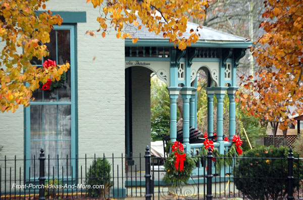 Madison Indiana front porch decorated with Christmas wreaths