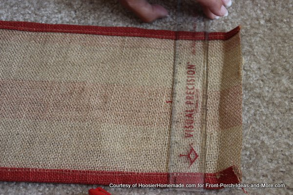 Liz marked the center of the burlap with a pen
