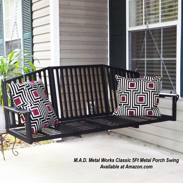 metal porch swing with colorful pillows on porch available at amazon