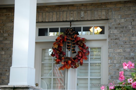 natural fall wreath uses leaf garland and plaid bow