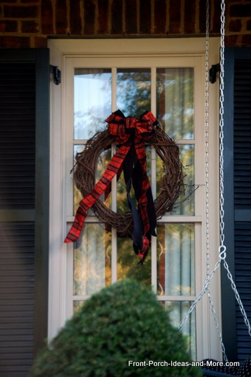 halloween wreath is simple gravevine with orange and black ribbons