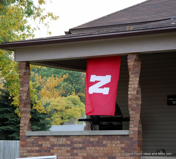 nebraska football flag flying from front porch with brick twisted columns