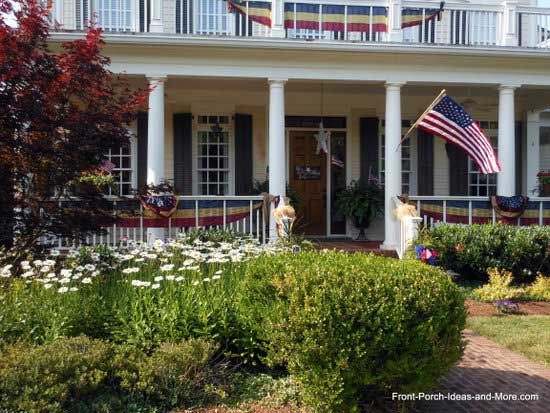 nostalgically decorated patriotic front porch