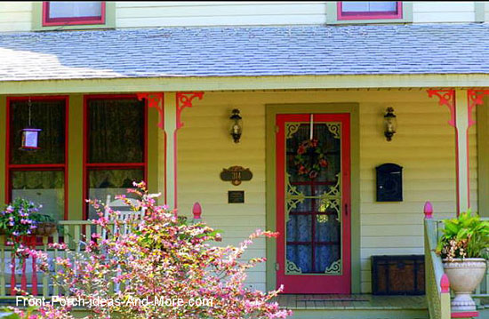 porch trim and front door painted in shade of red