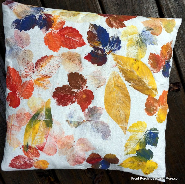 completed pillow topper with painted leaves