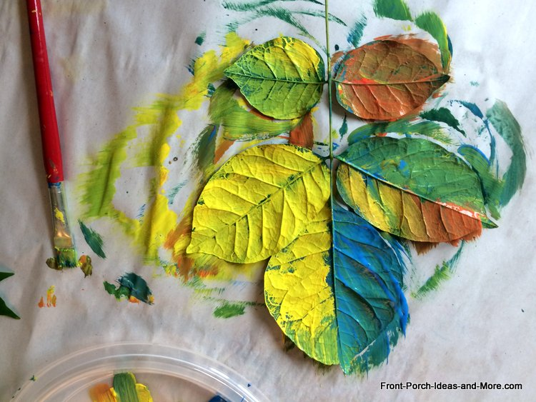 put paint onto backs of leaves