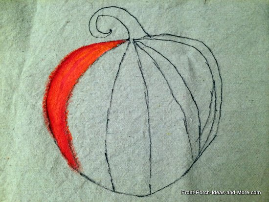 partially painted pumpkin pillow topper