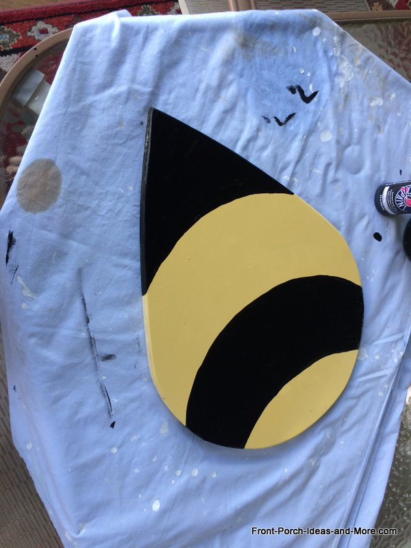 tear drop shape painted to resemble bumble bee
