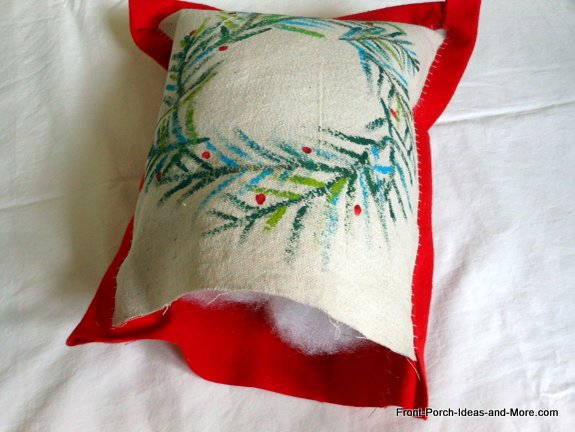 Fill the small pillow with fiberfill.